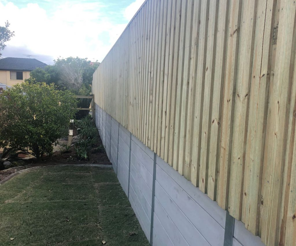 Durawall replaced retaining wall with concrete sleepers and timber fence