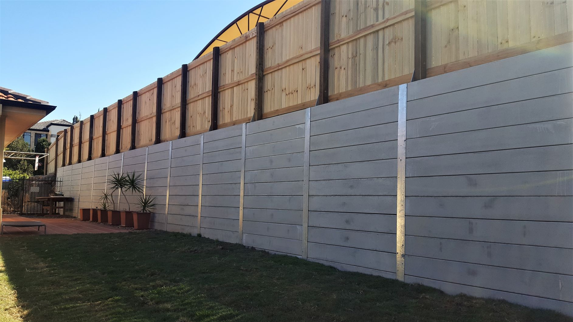 Durawall retaining wall and timber fence above two metres high