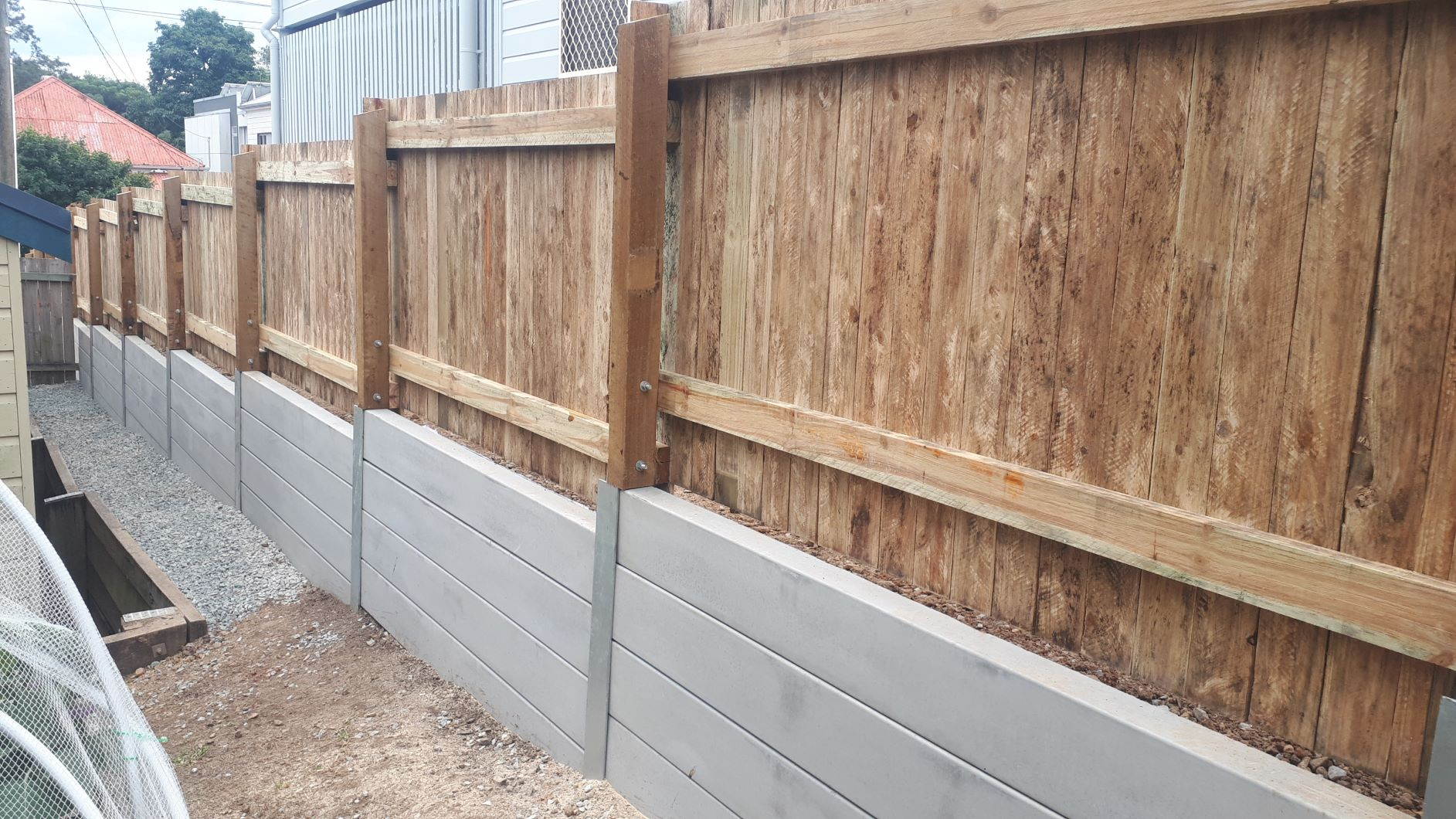 Durawall retaining wall and timber fence