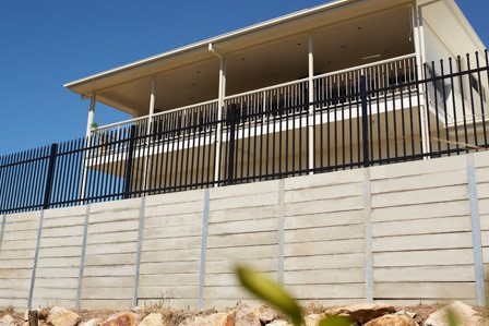 Durawall retaining wall with metal fence in Tingalpa