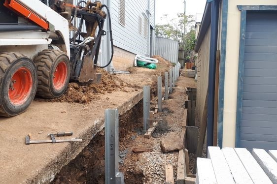 Durawall retaining wall and timber fence combo in Red Hill