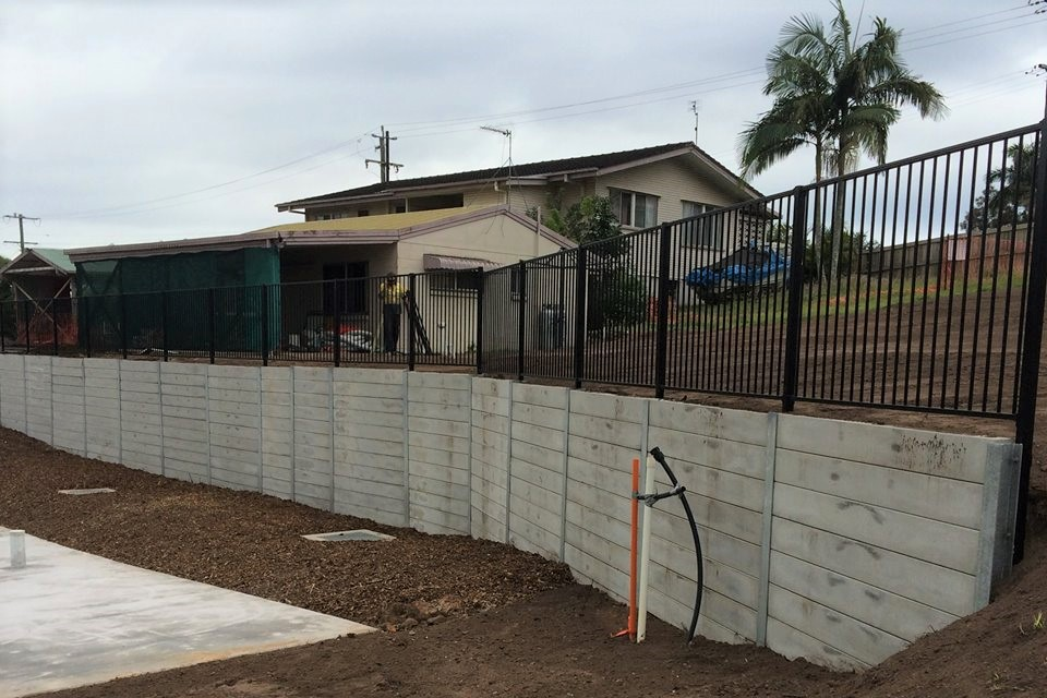 Durawall retaining wall with metal fence for subdivision in Bli Bli