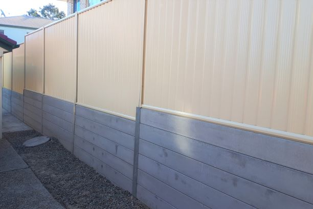 Durawall retaining wall replacement in Carina Heights after photo with Colorbond fence on top