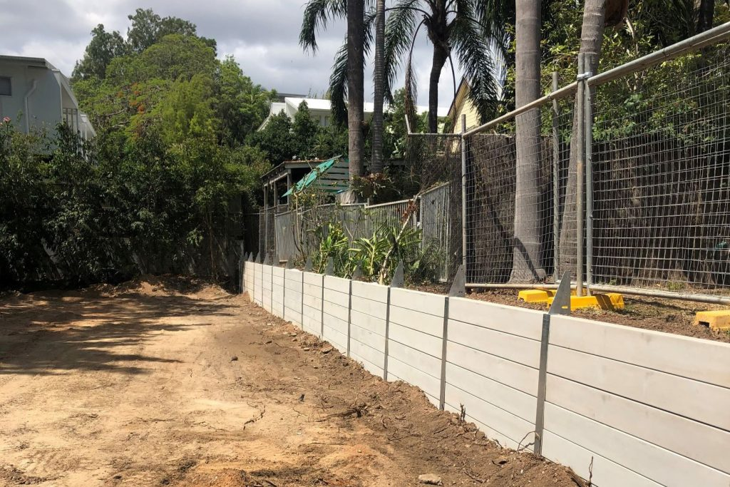 Durawall retaining wall on boundary inner Brisbane with fence brackets attached