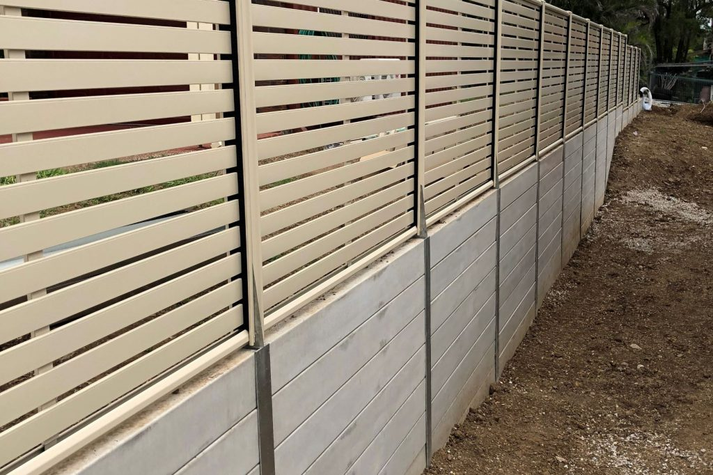 Durawall retaining wall replacement with slat screen fence in Bundamba after photo