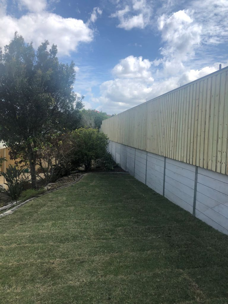 Durawall retaining wall replacement with timber fence at Carindale
