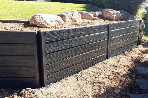 Durawall retaining wall replacement at Sinnamon Park driftwood concrete sleepers sealed in monument