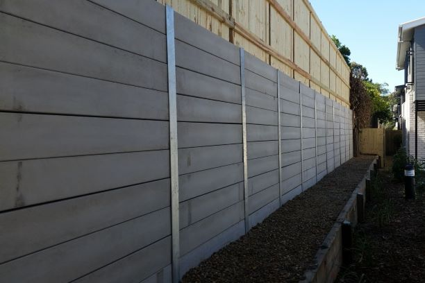 Durawall retaining wall replacement with timber fence after photo