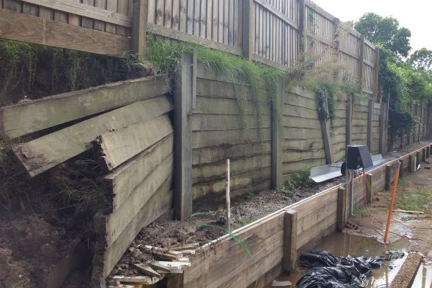 Durawall retaining wall replacement of fallen timber fence before photo