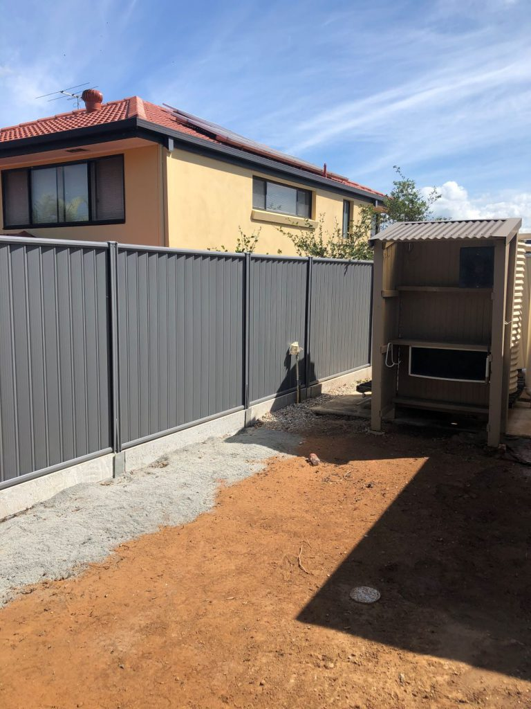 Durawall retaining wall in Carindale with Colorbond fence after photo