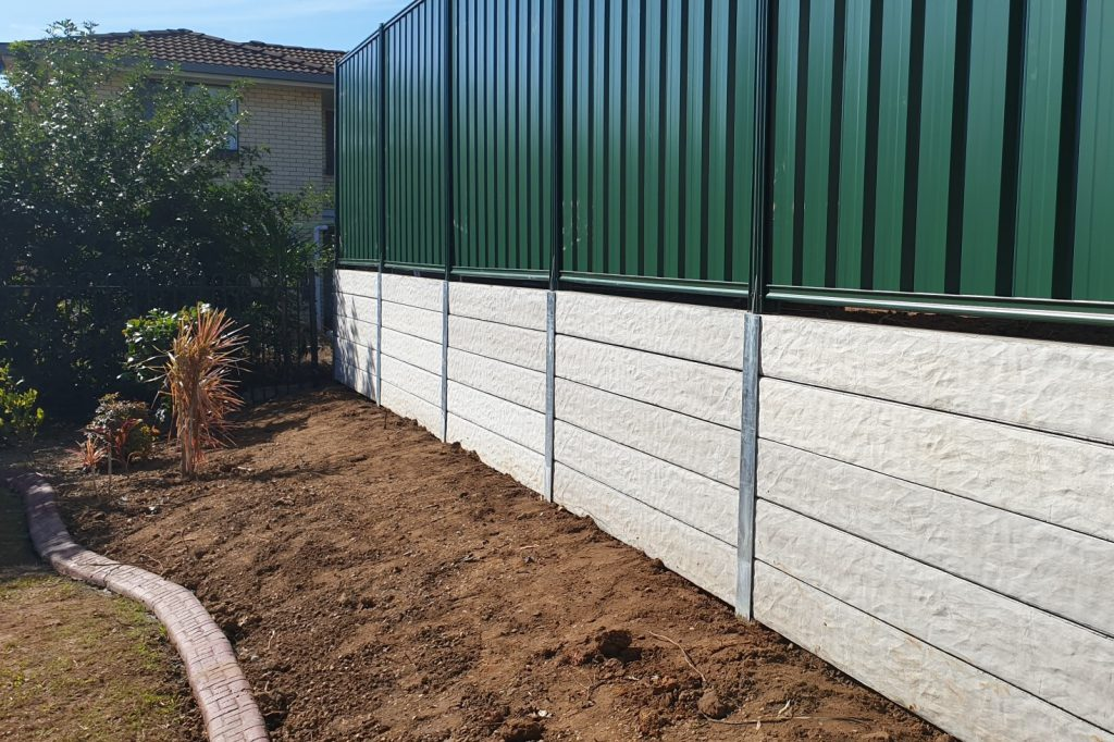 Durawall retaining wall replacement at Robertson after photo of granite stone sleepers and Colorbond fence