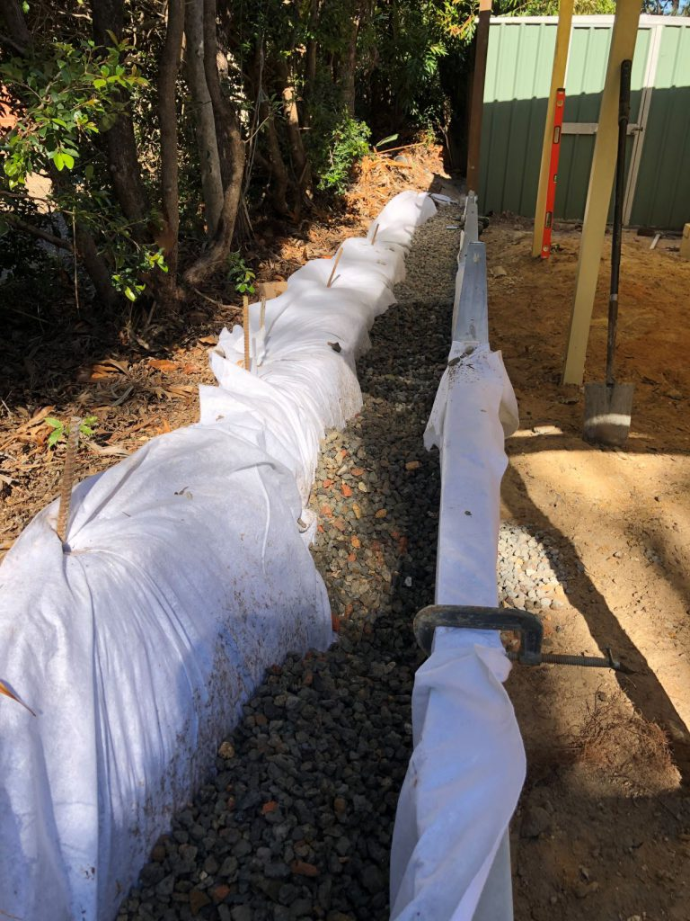 Durawall retaining wall replacement in Forest Lake drainage