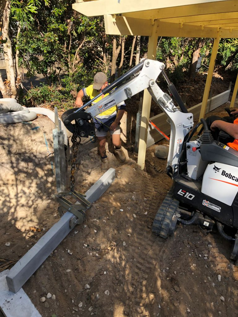 Durawall retaining wall replacement in Forest Lake loading sleepers