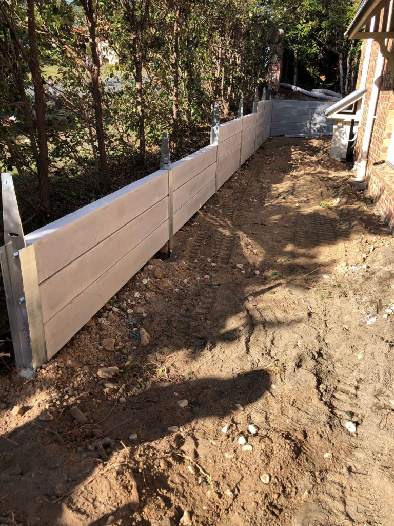 Durawall retaining wall replacement in Forest Lake loaded sleepers