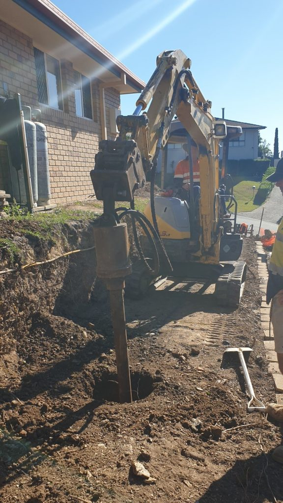 Durawall retaining wall replacement in Albany Creek drilling holes