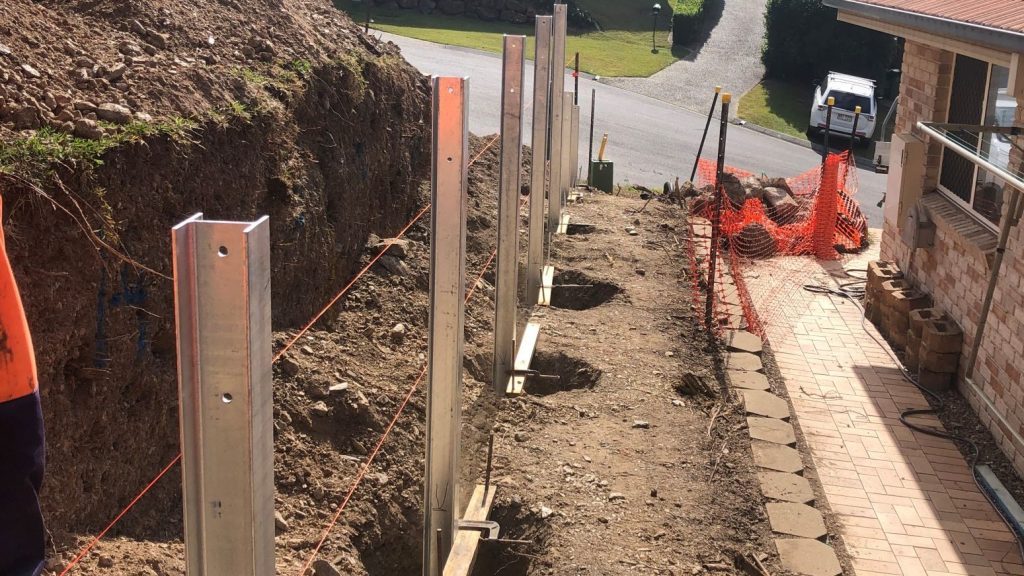 Durawall retaining wall replacement in Albany Creek setting posts