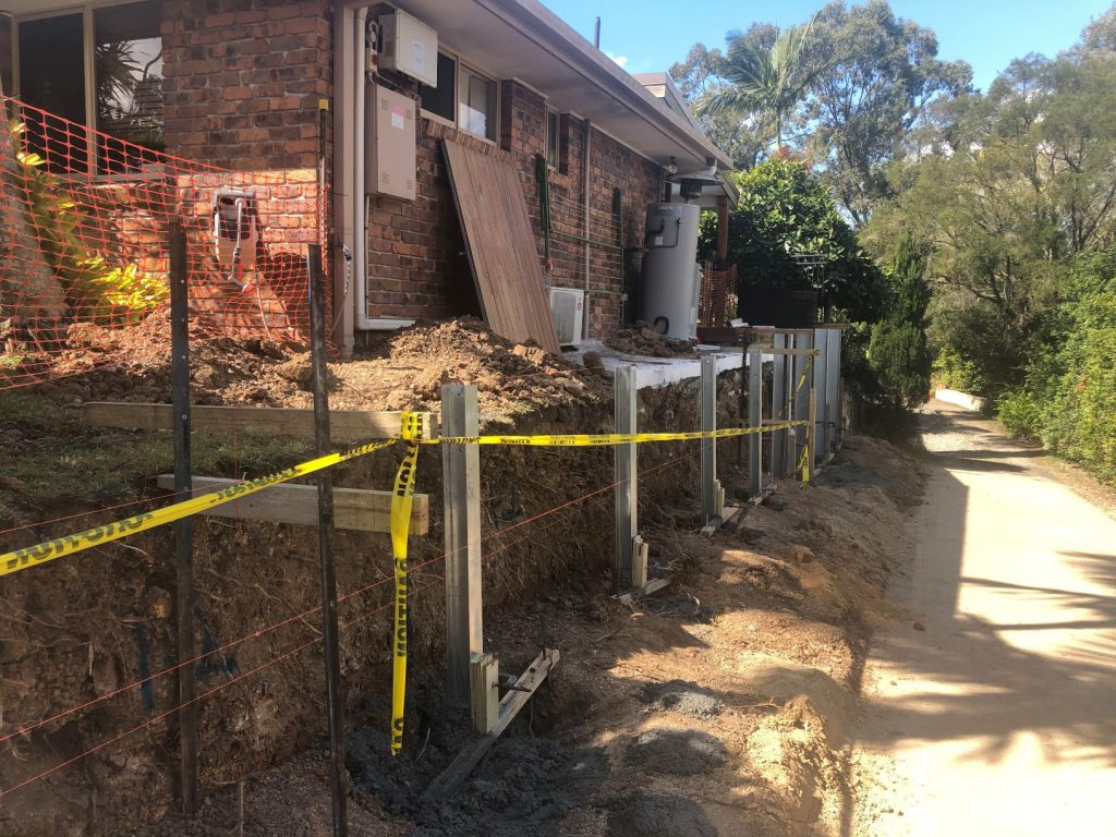 Durawall retaining wall replacement at Arana Hills setting posts