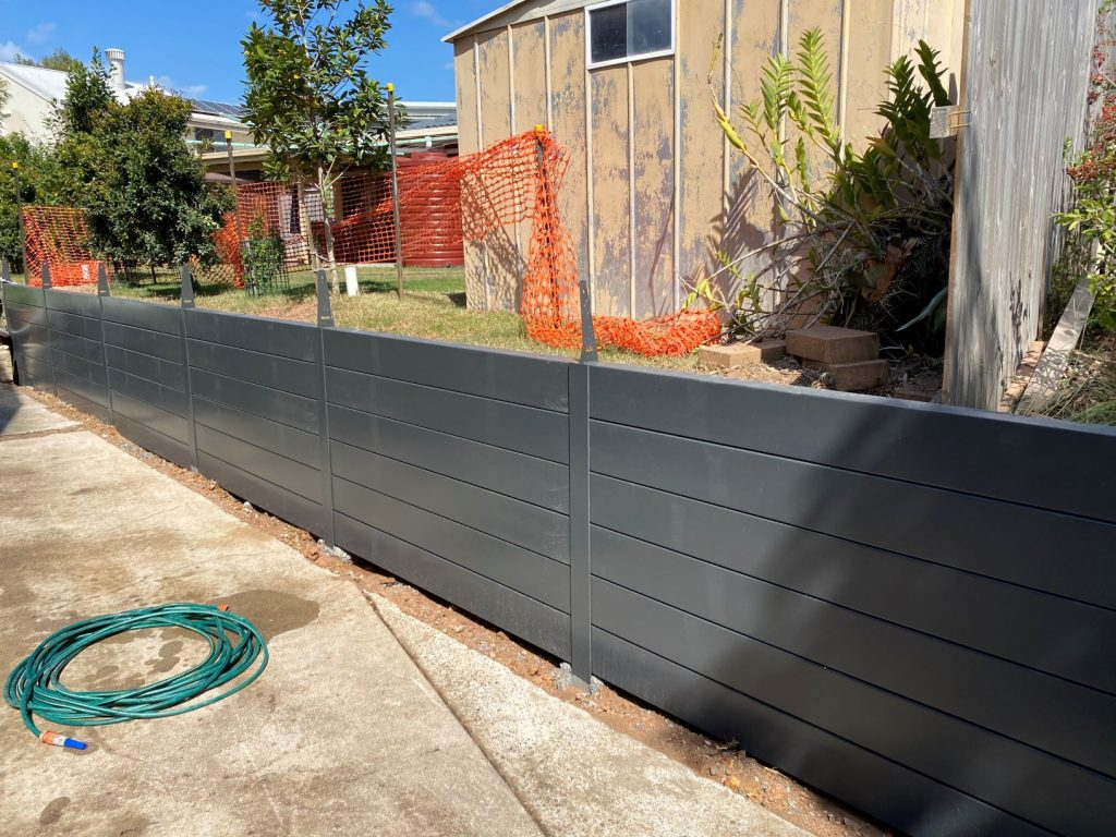 Durawall retaining wall monument and colorbond in Carindale sleepers