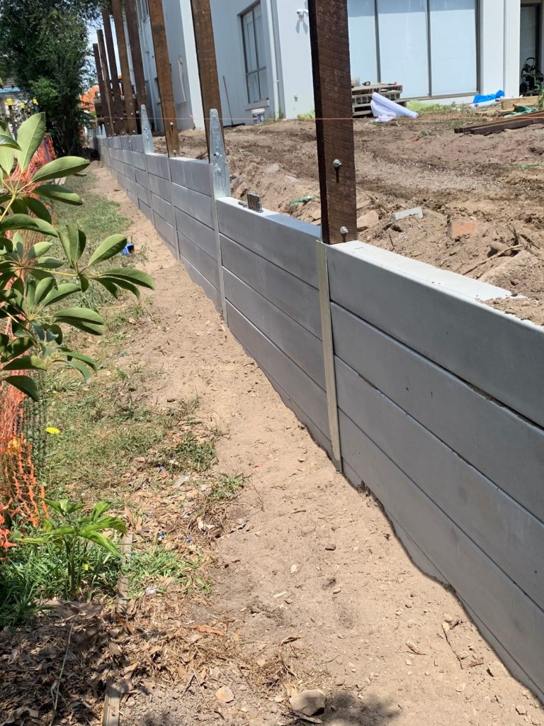 Durawall retaining wall replaced in Norman Park fence posts